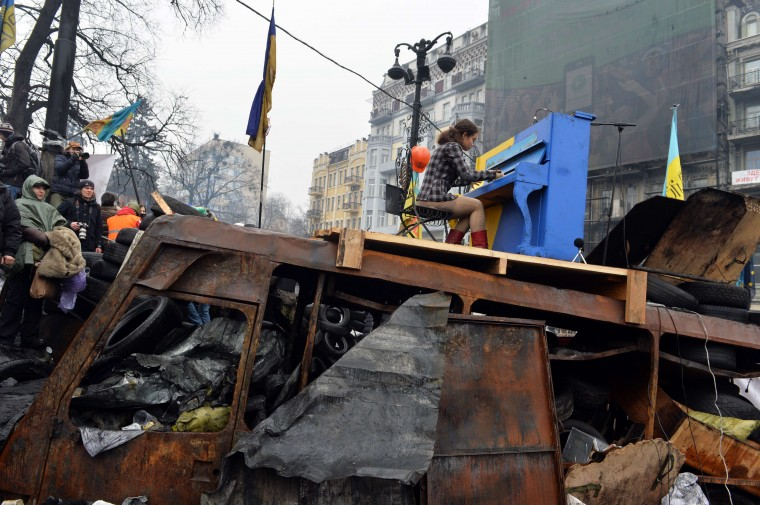 A Ukrainian artist plays the piano set on the anti-government opposition barricade in Kiev during a concert organized for the activists and for the policemen on February 10, 2014. Sergei Supinsky/AFP/Getty Images