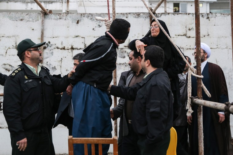 The mother (R) of Abdolah Hosseinzadeh, who was murdered in 2007, slaps Balal who killed her son during the execution ceremony in the northern city of Nowshahr on April 15, 2014 just before she removed the noose around his neck with the help of her husband, sparing the life of her son's convicted murderer. The dramatic events followed a rare public campaign to save the life of Balal, who at 19 killed another young man, Abdollah Hosseinzadeh, in a street fight with a knife back in 2007. ISNAARASH KHAMOOSHI/AFP/Getty Images