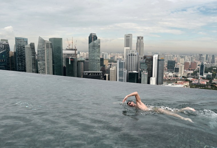 World Champion Christian Sprenger of Australia swims during a swimming clinic session for children with special needs on the rooftop pool of the Marina Bay Sands resort hotel in Singapore on May 20, 2014. Sprenger is in Singapore to promote the Singapore Swim Stars held in September, a three-day swim festival that includes an unprecedented competition format involving some of the world's best swimmers which will showcase a syncronised swimming as well as swimming clinics. ROSLAN RAHMAN/AFP/Getty Images