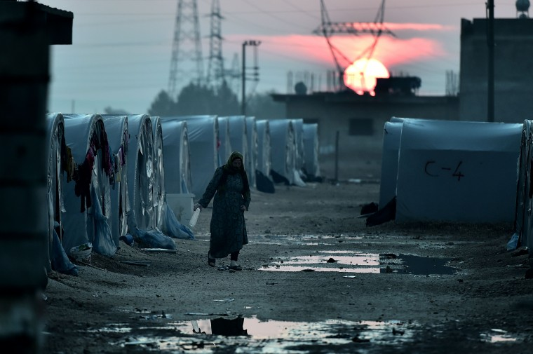 A Syrian Kurdish woman walks in a refugee camp in the town of Suruc, Sanliurfa province, on October 17, 2014. Kurdish rebels have been infuriated by the lack of action by Turkey against Islamic State (IS) jihadists trying to take the mainly Kurdish town of Kobane just across the Syrian border. ARIS MESSINIS/AFP/Getty Images
