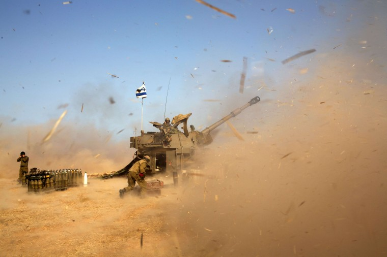 An Israeli artillery fires a 155mm shell towards targets in the Gaza Strip from their position near Israel's border with the Strip on July 12, 2014. Israel pounded Gaza for a fifth day today, vowing no let-up in its air campaign to halt rocket attacks by militants which has killed more than 120 Palestinians. MENAHEM KAHANA/AFP/Getty Images