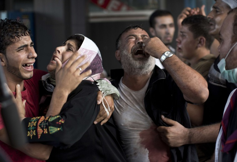 Palestinian mourners cry at Gaza City's al-Shifa hospital after an explosion killed at least seven children in a public playground in the beachfront Shati refugee camp on July 28, 2014. Palestinian medical sources blamed the killings on air strikes launched by the Israeli military, which in turn said Hamas had misfired its own rockets at the camp and at the Shifa hospital. MAHMUD HAMS/AFP/Getty Images