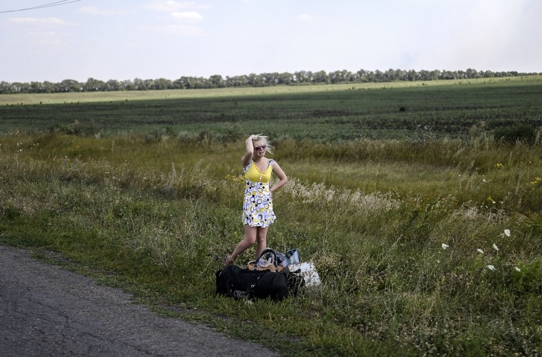 An Ukrainian girl cries as she stands on the road with her luggage after she left her home near the village of Hrabove (Grabovo), some 80km east of Donetsk on August 2, 2014. The insurgent stronghold of Lugansk in eastern Ukraine is on the verge a humanitarian catastrophe, the mayor warned Saturday, as a siege by government troops has seen water, electricity and food supplies cut off. BULENT KILIC/AFP/Getty Images