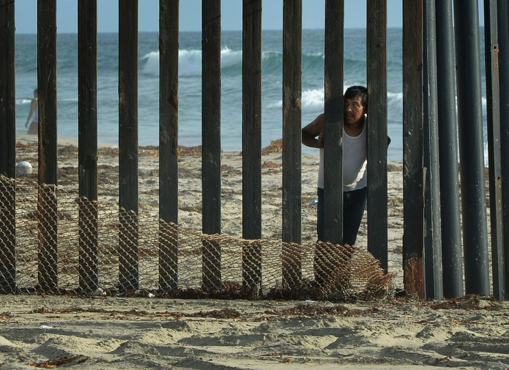 A man looks out towards the US from the Mexican side of the border fence that divides the two countries in San Diego on August 20, 2014. At least 57,000 unaccompanied children, most from Honduras, Guatemala and El Salvador, have crossed the border into the United States illegally since October, triggering a migration crisis that has sent US border and immigration authorities into a frenzy. MARK RALSTON/AFP/Getty Images