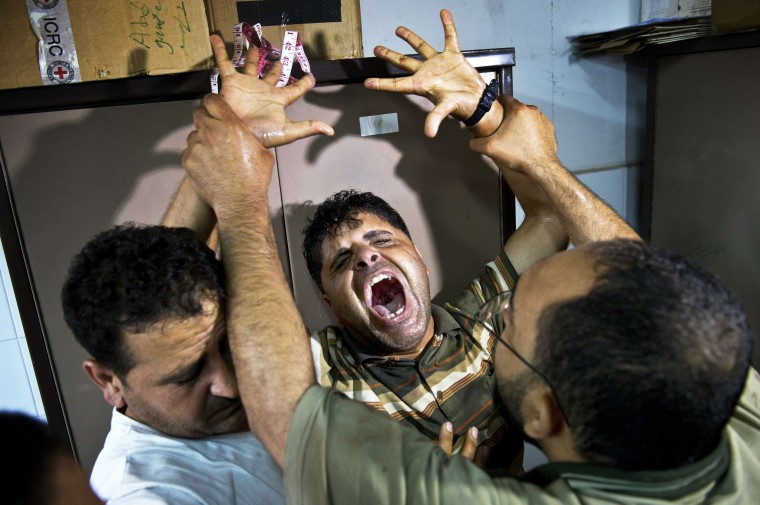 Tarek al-Rifi (C), the father of one of the three children from the Al-Rifi family killed in an Israeli military strike, reacts at Gaza city's Al-Shifa hospital on August 21, 2014. Israeli air strikes killed at least six Palestinians, four of them children, in the Gaza Strip, the spokesman for the emergency services said. According to the UN 2065 Palestinians have been killed since fighting broke between Israel and Hamas on July 8 and of those 467 are children. ROBERTO SCHMIDT/AFP/Getty Images
