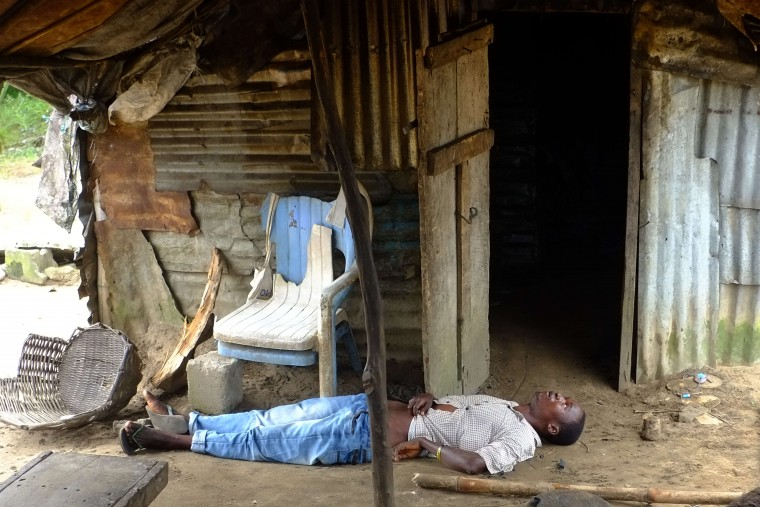 A man infected with the Ebola virus lies unconscious in his house on September 4, 2014 at the small city of Banjor, 30 kilometers of Monrovia. he Ebola virus has killed over 1,500 people in four west African countries since the start of the year, spreading through contact with infected bodily fluids. DOMINIQUE FAGET/AFP/Getty Images