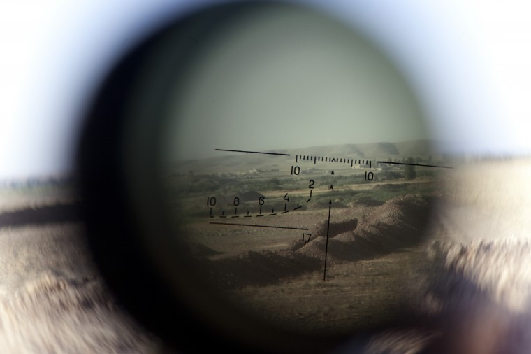 The horizon is seen through a telescopic rifle belonging to a Kurdish Peshmerga sniper on the front line in the Gwer district, 40 kilometres south of Arbil, the capital of the Kurdish autonomous region in northern Iraq, on September 15, 2014. Participants at an international conference in Paris pledged to support Iraq by all possible means to fight jihadists, including providing military support. JM LOPEZ/AFP/Getty Images