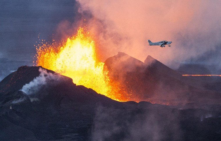 An aerial picture taken on September 14, 2014 shows a plane flying over the Bardarbunga volcano spewing lava and smoke in southeast Iceland. The Bardarbunga volcano system has been rocked by hundreds of tremors daily since mid-August, prompting fears the volcano could explode. Bardarbunga, at 2,000 metres (6,500 feet), is Iceland's second-highest peak and is located under Europe's largest glacier, Vatnajoekull. BERNARD MERIC/AFP/Getty Images