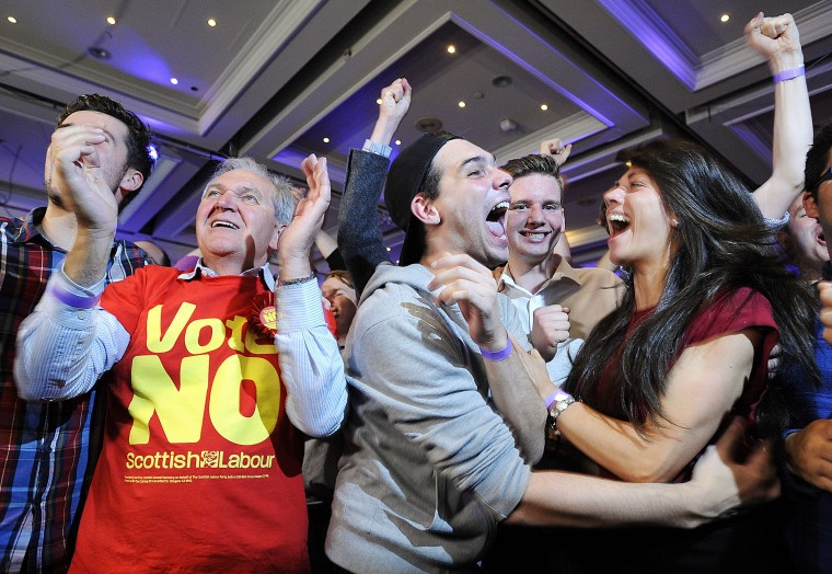 Pro-union supporters celebrate as Scottish independence referendum results are announced at a 'Better Together' event in Glasgow, Scotland, on September 19, 2014. Scotland appeared set to reject independence on Friday with 23 out of 32 voting areas declared and the crucial Glasgow region having given its result. ANDY BUCHANAN/AFP/Getty Images