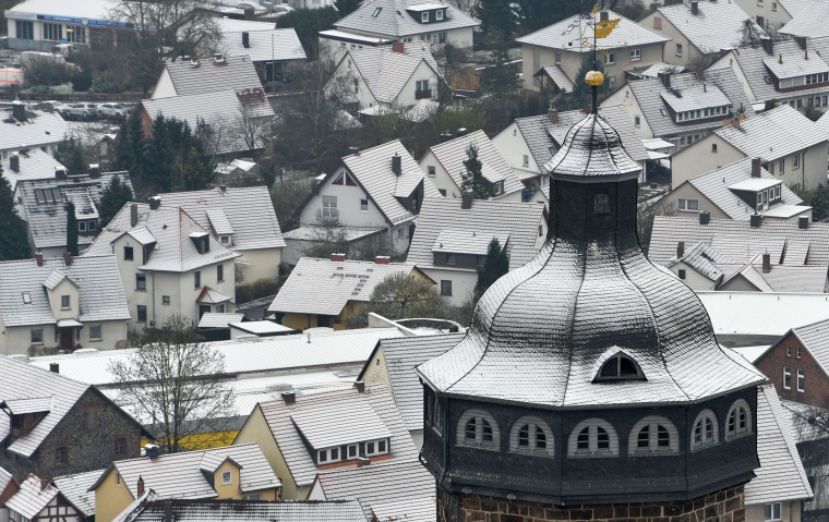 A thin layer of snow covers the roofs and the tower of the St Marien church in Homberg / Efze, central Germany, on December 3, 2014. (Uwe Zucchi/AFP/Getty Images)