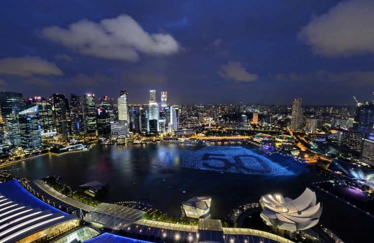 Singapore's skyline gliters with lights as spheres in the waters of Marina Bay form the number '50' to mark Singapores 50th anniversary in 2015, ahead of the New Year's countdown celebrations in Singapore on December 31, 2014. (Mohd Fyrol/AFP/Getty Images)