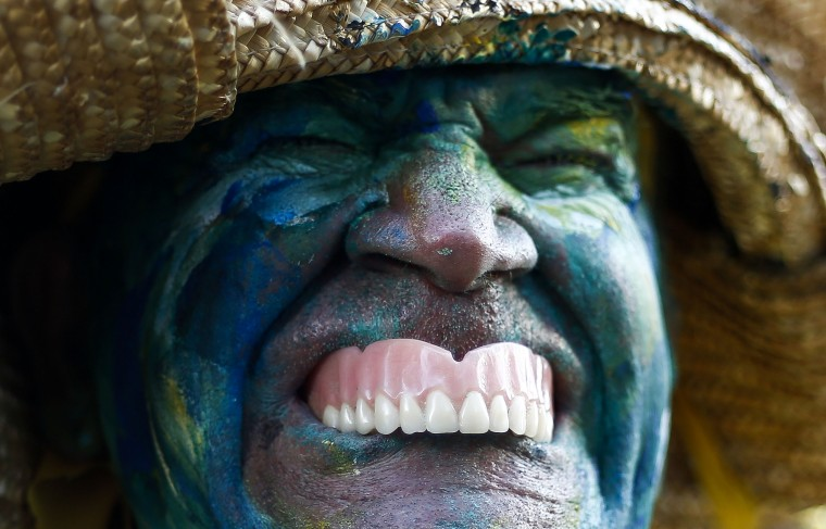 A man in costume is seen before the 90th Sao Silvestre international 15 km race in Sao Paulo, Brazil, on 31 December 2014. Thirty thousand runners participated in the 15 km traditional New Year's Eve event. (Miguel Shincariol/AFP/Getty Images)