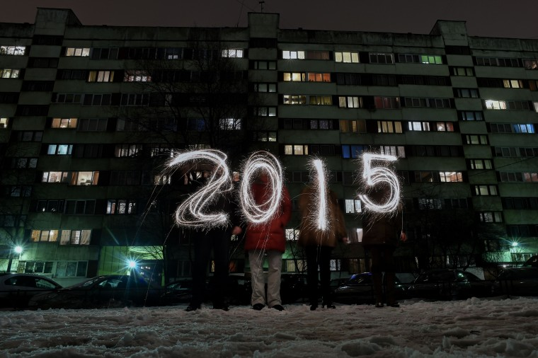 "People write ""2015"" with sparklers as they celebrate the New Year in the suburb of St. Petersburg late on December 31, 2014. New Year's is the biggest holiday of the year in Russia, followed by Orthodox Christmas celebrated on January 7. (Kirill Kudryavtsev/AFP/Getty Images)"
