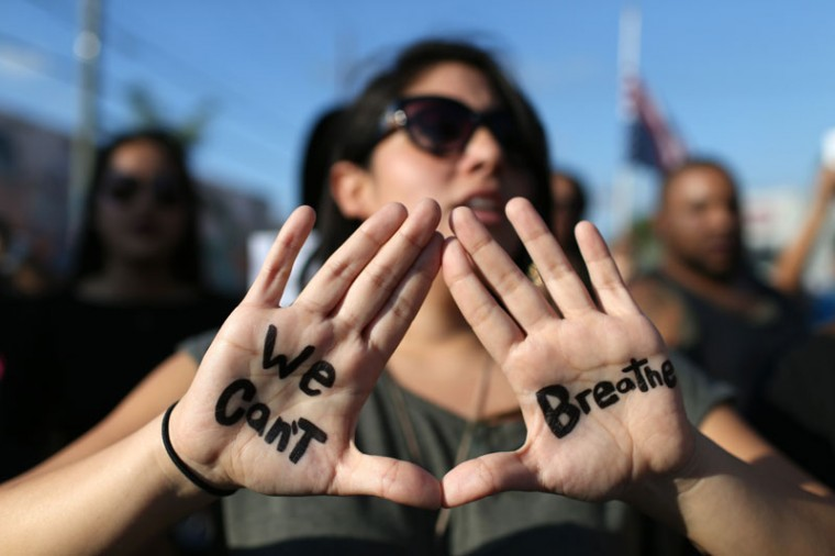 Demonstrators march through the Wynwood neighborhood to protest police abuse on December 7, 2014 in Miami, Florida. The protest was one of many that have take place nationwide after grand juries investigating the deaths of Michael Brown in Ferguson, Missouri and Eric Garner in New York failed to indict the police officers involved in both incidents (Joe Raedle/Getty Images)
