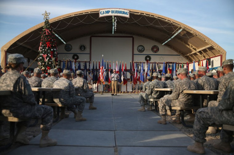 U.S. Secretary of Defense Chuck Hagel speaks to U.S. troops during a visit, December 8, 2014 at Camp Buehring, Kuwait. Secretary Hagel visited the camp which once was a staging post for troops headed to Iraq. (Mark Wilson/Getty Images)