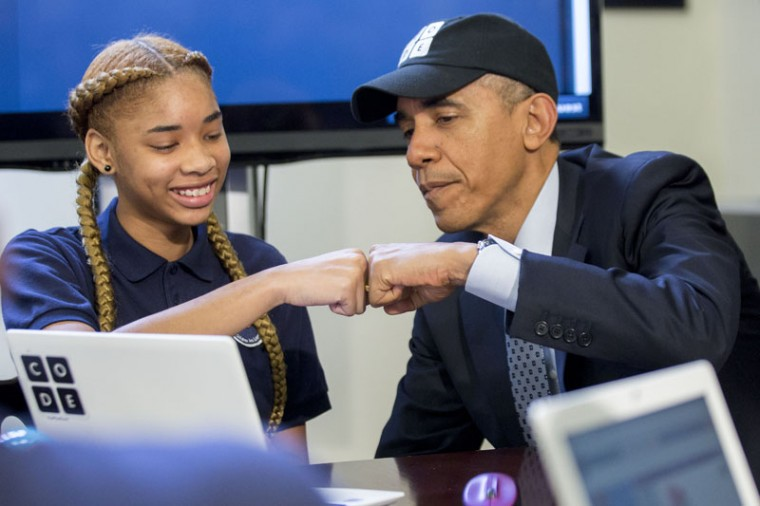 "U.S. President Barack Obama fist-bumps middle-school student Adrianna Mitchell while participating in an ""Hour of Code"" event in the Eisenhower Executive Office Building next to the White House on December 8, 2014 in Washington, DC. The event is in honor of Computer Science Education Week. (Andrew Harrer-Pool/Getty Images)"