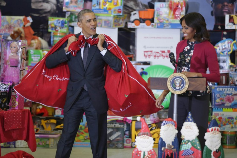 U.S. President Barack Obama (Left) and first lady Michelle Obama deliver toys and gifts donated by Executive Office of the President staff to the Marine Corps Reserve Toys for Tots Program at Joint Base Anacostia-Bolling in Washington, DC. For 67 years the Toys for Tots program has worked with local communities to collect and distribute toys and gifts for less fortunate children throughout the United States. (Chip Somodevilla/Getty Images)