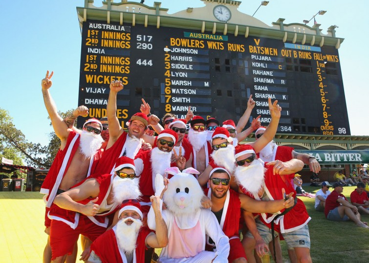 Spectators dressed as Santa Claus watch the cricket on the hill during day five of the First Test match between Australia and India at the Adelaide Oval on December 13, 2014 in Adelaide, Australia. (Scott Barbour/Getty Images)