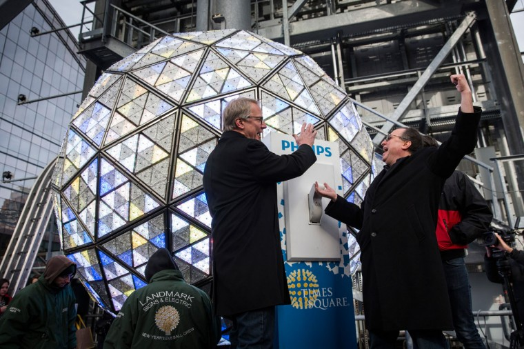 Jeffrey Straus (R), president of Countdown Entertainment and Brent Shafer, CEO of Philips North America, test flipping the switch on the Times Square crystal ball before tomorrow night's New Year's Eve celebration on December 30, 2014 in New York City. The ball is illuminated with 32,256 LED lights and is made up of 2,688 Waterford crystals. (Andrew Burton/Getty Images)