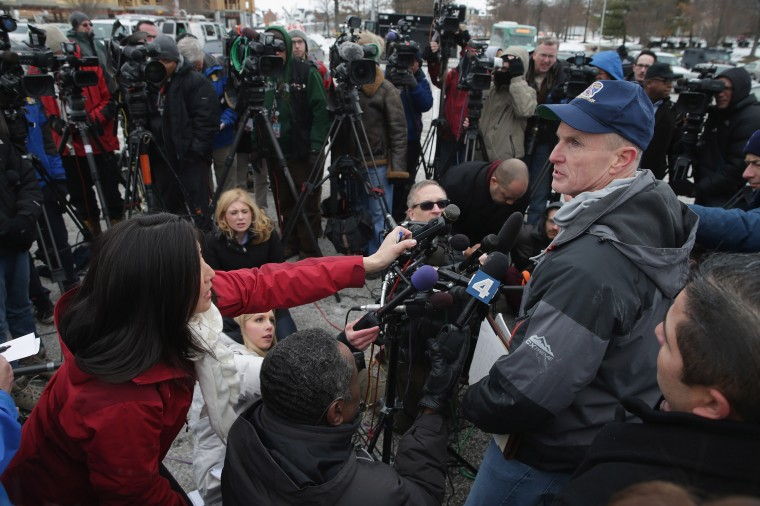 Howard County, Maryland, Police Chief William J. McMahon talks to reporters outside Columbia Town Center Mall following a shooting situation January 25, 2014 in Columbia, Maryland. Three people are dead, including the shooter, after a man opened fire inside the mall. (Photo by Chip Somodevilla/Getty Images)