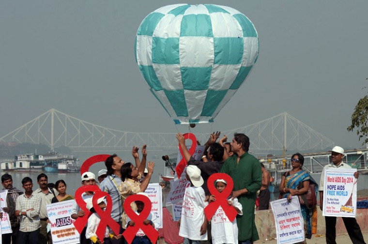 Indian children and social activists release a symbolic hot air balloon during a meeting to create awareness about AIDS on the eve of world AIDS day in Kolkata on November 30, 2014. World AIDS Day is marked annually on December 1. (Dibyangshu Sakar/AFP/Getty Images)