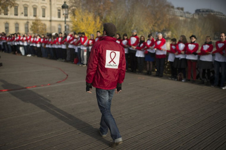 People take part in a rally marking world AIDS day, on November 30, 2014 in Paris. (Martin Bureau/AFP/Getty Images)