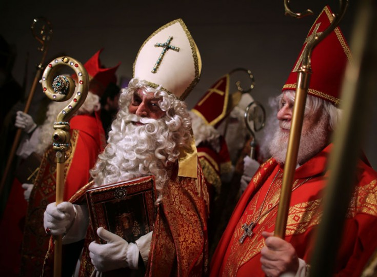 Men dressed as Santa Claus stand together during a Santa Claus meeting in Cologne, western Germany, on November 30, 2014. Around 70 participants came to the event. (Oliver Berg/AFP/Getty Images)
