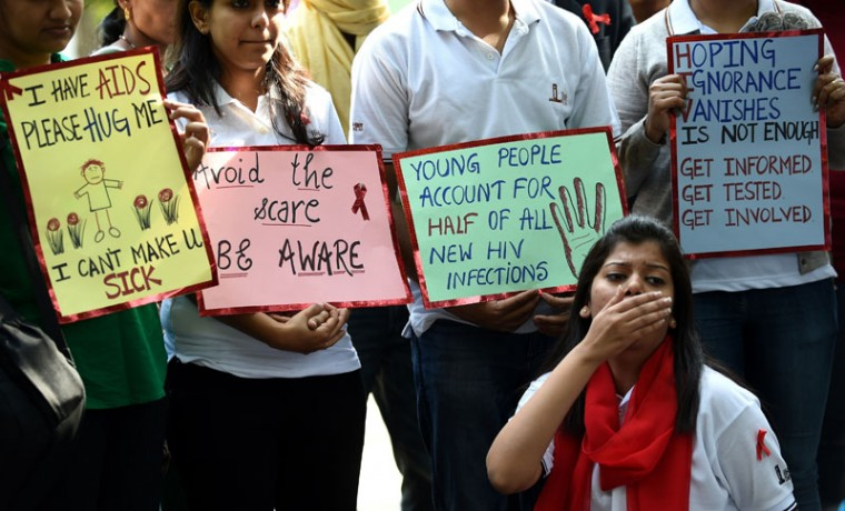 Indian students perform a street play to create awareness of HIV infection and prevention methods to commemorate World AIDS Day in New Delhi on December 1, 2014. According to the UN AIDS program, India had the third-largest number of people living with HIV in the world at the end of 2013 and it accounts for more than half of all AIDS-related deaths in the Asia-Pacific region. In 2012, 140,000 people died in India because of AIDS. The Indian government has been providing free antiretroviral drugs for HIV treatment since 2004, but only 50 percent of those eligible for the treatment were getting it in 2012, according to a report by the World Health Organization. (Sajiad Hussain/AFP/Getty Images)