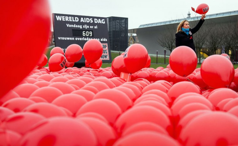 Angela Groothuizen, Dutch ambassador for Stop AIDS Now, releases red balloons representing women who have died of the disease on World AIDS Day at the Museumplein in Amsterdam on December 1, 2014. (Koen Van Weel/AFP/Getty Images)