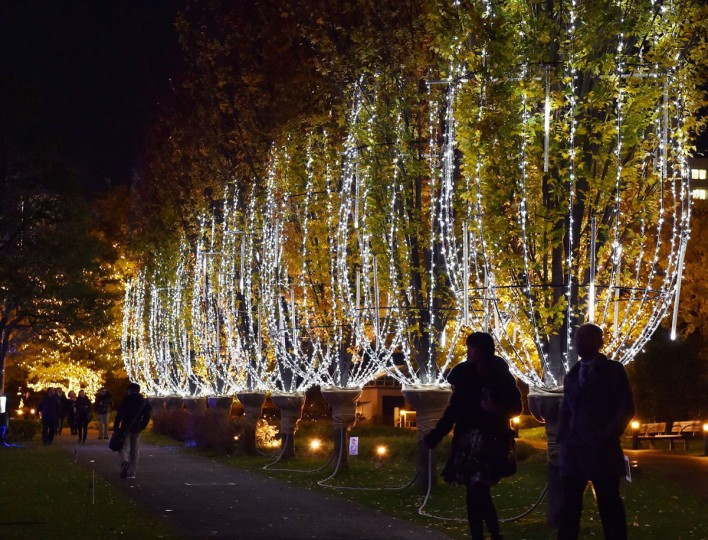 People stroll under champagne glasses shaped illumination with 20,000 white LED lights in Tokyo on December 2, 2014. Shoppers enjoyed a Christmas atmosphere with hundreds of thousands of LED lights illumination which will be displayed throughout Christmas Day. (Yoshikazu Tsuno/AFP/Getty Images)