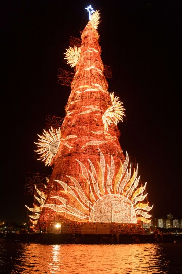 A 85-meter-high floating Christmas tree illuminates the Rodrigo de Freitas lagoon in Rio de Janeiro, Brazil, on December 2, 2014. The world highest floating Christmas tree registered by the Guiness World Records will be illuminated by 3,1 million lights every night until January 6, 2015. (Yasu Yoshi Chiba/AFP/Getty Images)
