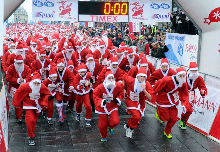 Runners wearing Santa Claus costumes take the start at the 'Santa Claus Run' in downtown Budapest on December 6, 2014. About 3000 runners took part in this year's run. (Attila Kisbenedek/AFP/Getty Images)