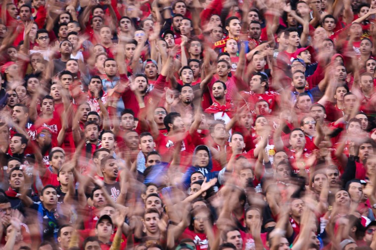 Egypt's Al-Ahly supporters cheer for their team before the second leg of their CAF Confederation Cup final football match against Ivory Coast's Sewe Sport at the Cairo Stadium on December 6, 2014, in the Egyptian capital. Sewe Sport won the first leg 2-1. (MOHAMED EL-SHAHED/AFP/Getty Images)