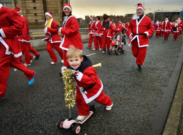Runners dressed in Father Christmas costumes take part in the annual five kilometer Santa Dash in Liverpool, north-west England, on December 7, 2014. Organizers were hoping to attract more than 10,000 runners for the 10th annual race. Many runners wear a blue suit, usually supporters of Everton football club, who refuse to run in red and white, the colors of their city rivals Liverpool FC. (Paul Ellis/AFP/Getty Images)