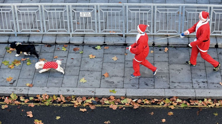 Runners make their way to the start dressed in Father Christmas costumes to take part in the annual five kilometer Santa Dash in Liverpool, north-west England, on December 7, 2014. Organizers were hoping to attract more than 10,000 runners for the 10th annual race. Many runners wear a blue suit, usually supporters of Everton football club, who refuse to run in red and white, the colors of their city rivals Liverpool FC. (Paul Ellis/AFP/Getty Images)