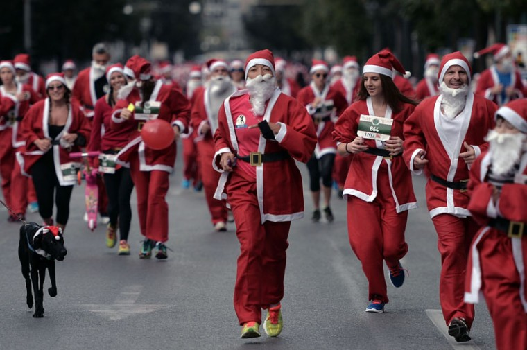 Runners wearing Santa Claus costumes take part in the first Athens 'Santa Claus Run' in city's center on December 7, 2014 . AFP (Louisa Gouliamaki/AFP/Getty Images)