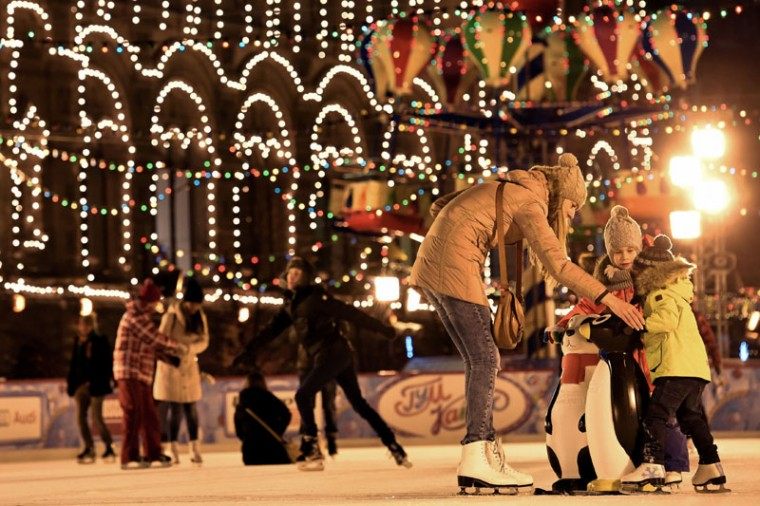 People ice skate during the annual Christmas fair on Red Square in Moscow on December 8, 2014. New Year's is the biggest holiday of the year in Russia, followed by Orthodox Christmas celebrated on January 7. (Kirill Kudryavtsev/AFP/Getty Images)