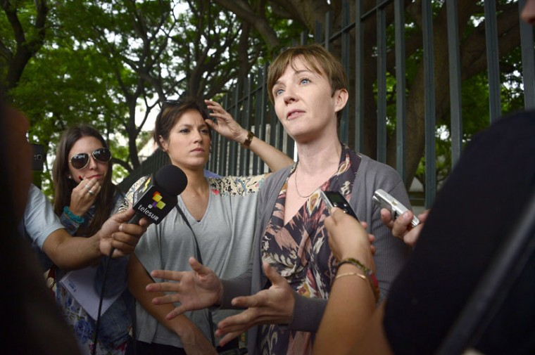 "Cori Crider, lawyer of the Syrian national recently freed from Guantanamo prison Abu Wael Dhiab, speaks to the press outside of the Military Hospital in Montevideo on December 8, 2014. Six Guantanamo inmates transferred to Uruguay were to leave hospital in freedom after more than a decade in what one called the ""black hole"" of the US military prison. (Pablo Porciuncula/AFP/Getty Images)"