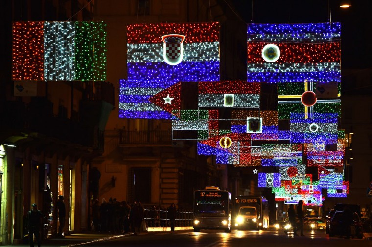A picture shows christmas lights representing the national flags of different countries in the Via del Corso in Rome on December 9, 2014. (Gabriel Bouys/AFP/Getty Images)