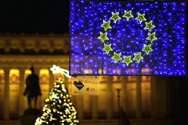 A picture shows christmas lights representing the European flag with the Vittoriano monument in the background in Rome on December 9, 2014. (Gabriel Bouys/AFP/Getty Images)