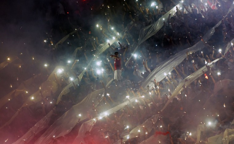 Argentina's River Plate supporters cheer for their team during the Copa Sudamericana 2014 second leg final football match against Colombia's Atletico Nacional at the Monumental stadium in Buenos Aires, Argentina. (Juan Mabromata/AFP/Getty Images)
