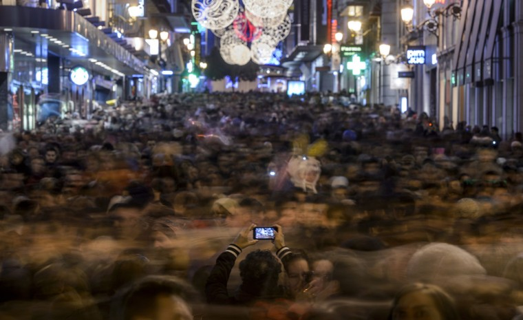 Pedestrians crowd a street decorated with christmas lights in the centre of Madrid . (Dani Pozo/AFP/Getty Images)