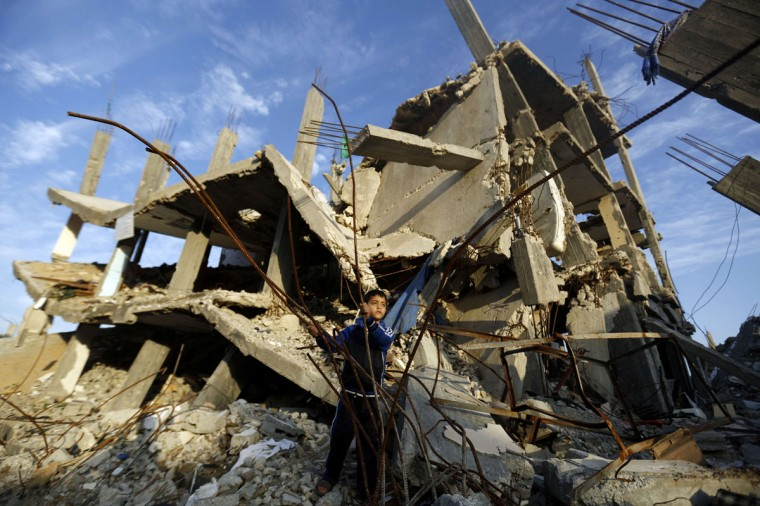 A Palestinian boy plays in the rubble of a house destroyed during the 50 days of conflict between Israel and Hamas last summer, in the Shejaiya neighborhood of Gaza City, on December 11, 2014. (Mohammed Abed/AFP/Getty Images)