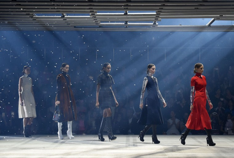 Models display creations during the fall 2015 fashion show by French fashion brand Dior in Tokyo on December 11, 2014. (Toru Yamanaka/AFP/Getty Images)