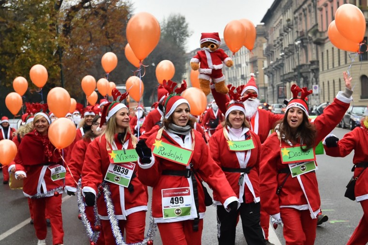 People wear Santa Claus costumes as they take part in a Santa Claus themed race in downtown Milan on December 13, 2014. (Giuseppe Cacace/AFP/Getty Images)