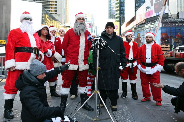 Santa holds a news conference in Times Square as hundreds of Santas gather for the annual Santacon festivities on December 13, 2014 in New York. (Don Emmert/AFP/Getty Images)