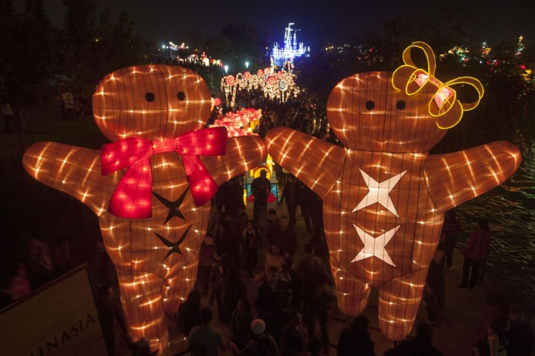 """People enjoy Christmas show """"Luminasia"""", the biggest figures light show in Latin America, in Monterrey, Nuevo Leon, on December 13, 2104. (Julio Cesar Aguilar/AFP/Getty Images)"""