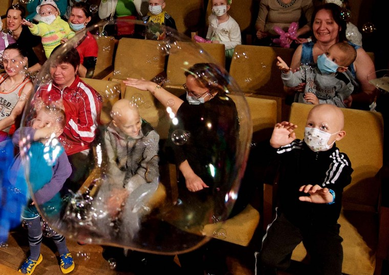Children and their parents watch a New Year performance at the children's hematological and oncological centre in Minsk on December 15, 2014. (Maxim Malinovsky/AFP/Getty Images)