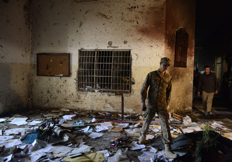 A Pakistani soldier walks amidst the debris in an army-run school a day after an attack by Taliban militants in Peshawar on December 17, 2014. Militants rampaged through an army-run school in the northwestern city of Peshawar and killed at least 141 people, almost all of them children, in the bloodiest ever terror attack in Pakistan. A Majeed/AFP/Getty Images