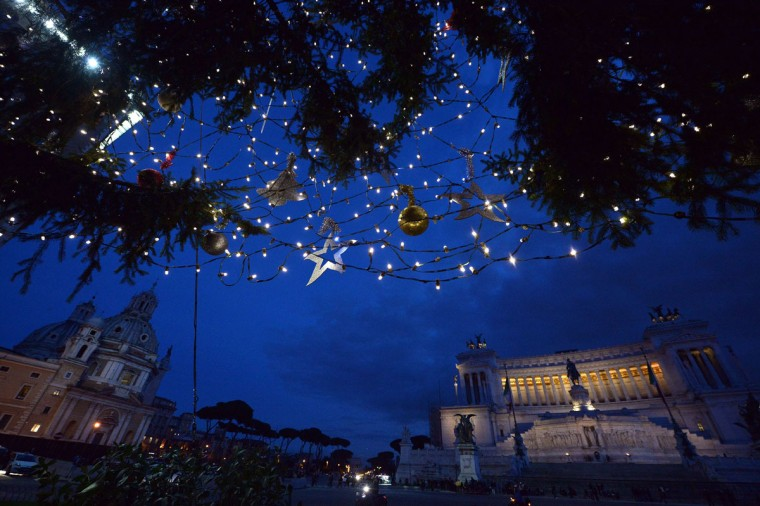 A picture shows Christmas lights on a pine tree at Piazza Venezia with the Vittoriano monument in the background on December 17, 2014 at night. (Tiziana Fabi/AFP/Getty Images)